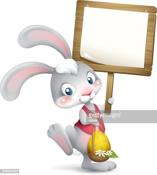 easter bunny holding sign - easter bunny stock illustrations