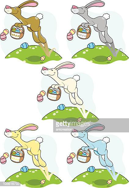 easter bunny hopping and dropping - easter bunny stock illustrations
