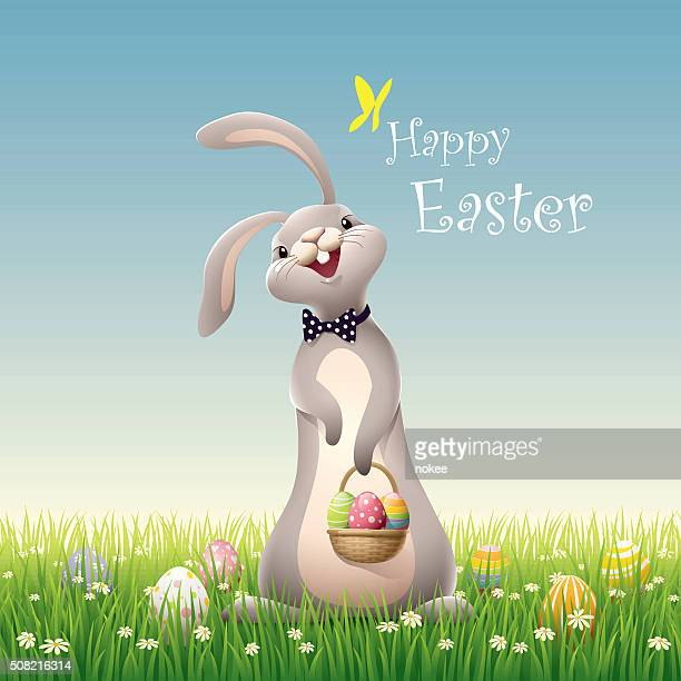 easter bunny on green grass - easter bunny stock illustrations