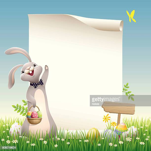 easter bunny with paper sroll on green grass - easter bunny stock illustrations