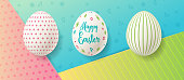 Easter eggs on colorful paper background with cute pattern