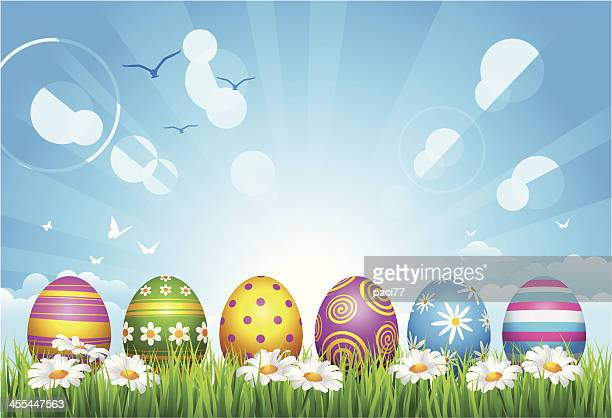 easter eggs on grass - small group of objects stock illustrations