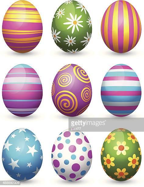 easter eggs on grass - easter egg stock illustrations