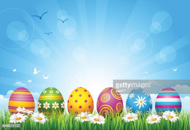 easter eggs on grass - easter stock illustrations, clip art, cartoons, & icons
