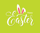 Easter lettering with bunny ears on green background.