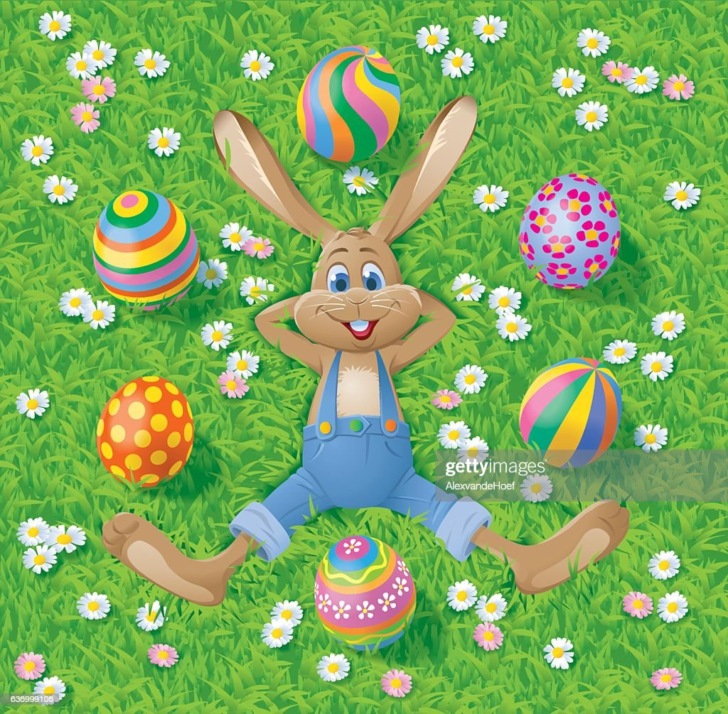 Easterbunny with eastereggs on grass : stock illustration
