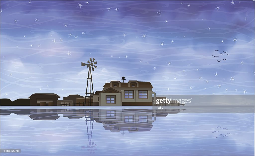Ecological farm reflecting in clear blue water