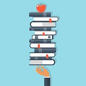 Education and knowledge concept. Hand holding bunch of books with apple on top. Flat vector illustration