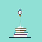 education startup concept rocket launch from book