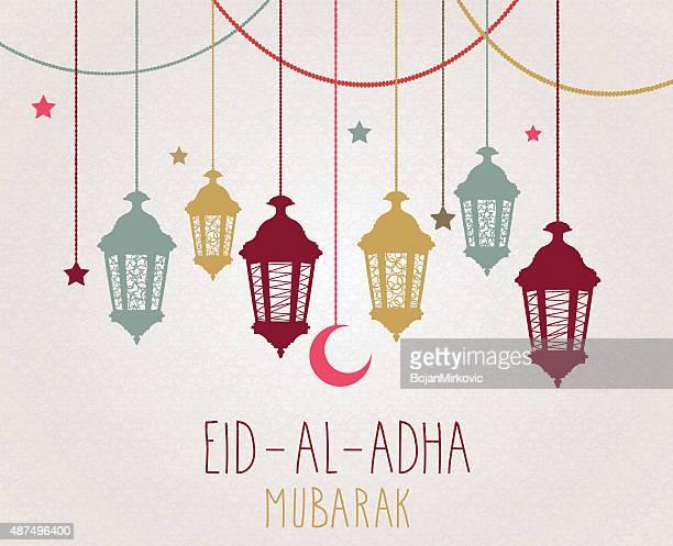 eid al adha mubarak poster. hanging colorful lantern - eid al adha stock illustrations
