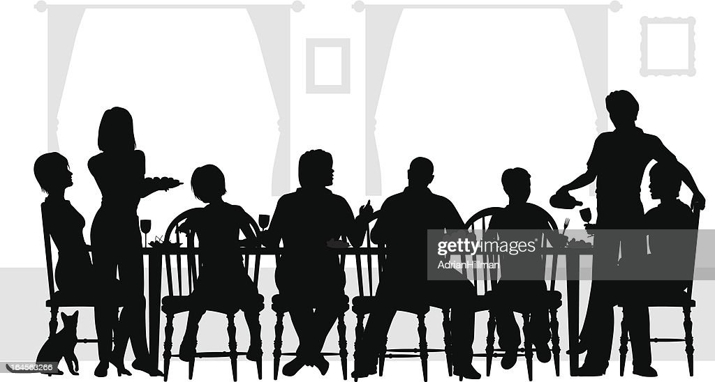 Eight family members eating at the table with wine