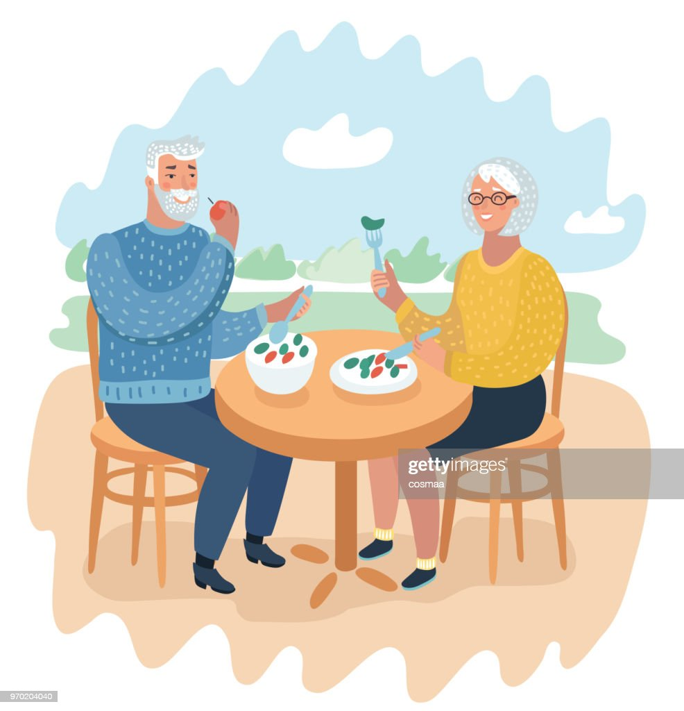 Elderly couple at a cafe eating