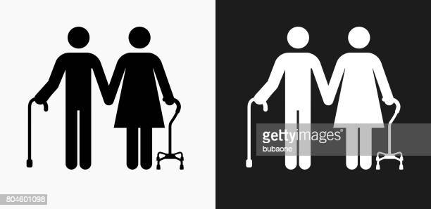 Elderly Couple Icon on Black and White Vector Backgrounds