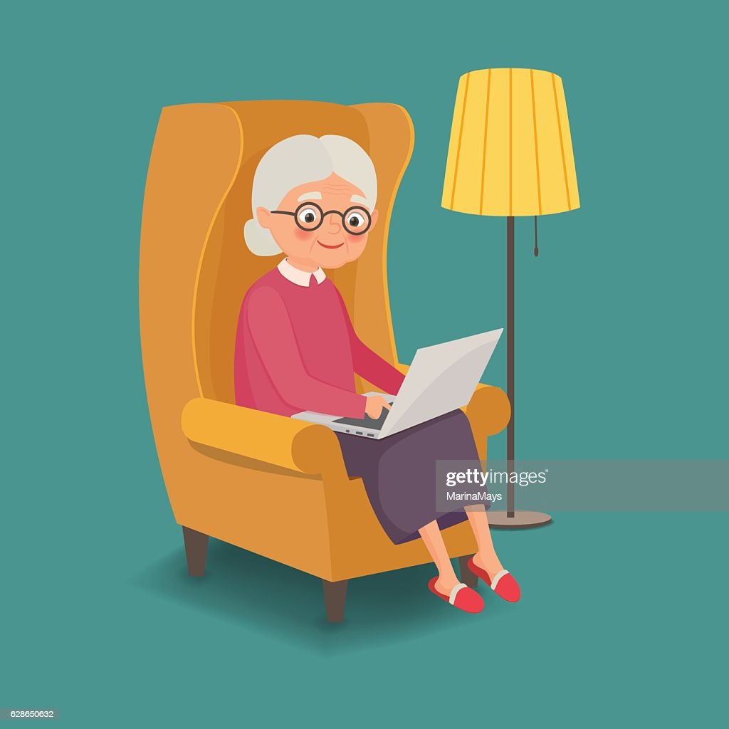 Elderly woman sitting in a chair with a laptop