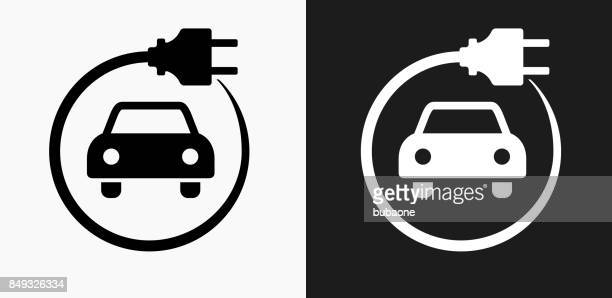electric car icon on black and white vector backgrounds - electric plug stock illustrations