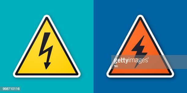 electricity danger warning symbols - igniting stock illustrations