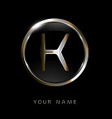Elegance modern trendy stylish circular shaped brandswith metallic color K initial based letter icon.