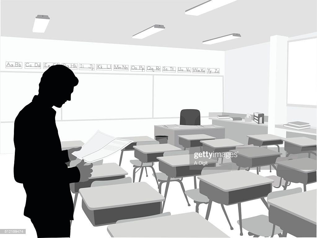 Elementary School Teacher In His Classroom