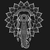 Elephant head on lotus mandala. Popular motiff in Asian arts and crafts. Intricate hand drawing isolated on background. Imitation of chalk on blackboard. Tattoo design.