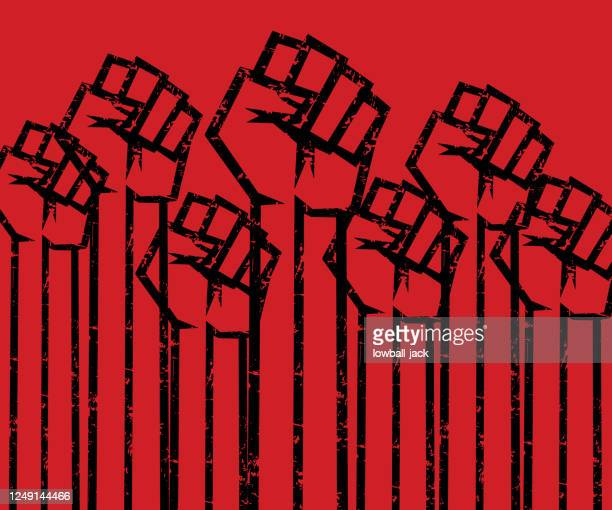 eliminate racial discrimination, say no to racism raised fists grunge vector stock illustration. - social justice concept stock illustrations