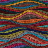 Embroidered wavy seamless pattern. Colorful ornament.