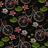 Embroidery bicycle and water lilies flowers seamless pattern. Fashionable summer pattern embroidery bicycle and lotus flowers  romantic art, template clothes, t-shirt design art