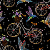 Embroidery bicycle violets flowers and humming birds seamless pattern. Fashionable summer pattern embroidery bicycle humming bird and violets romantic art, template clothes