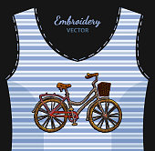 Embroidery bicycle with basket on undershirt in blue strip. Fashionable embroidery bicycle, spring art, template for romantic clothes, t-shirt design art