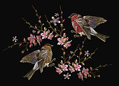Embroidery birds and blossoming cherry vector. Classical embroidery bullfinch and titmouse on branch blossoming sakura. Spring fashion art, template for design of clothes, t-shirt design