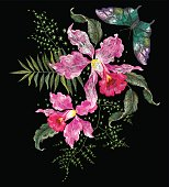 Embroidery brigt trend floral pattern with orchids and butterfly.