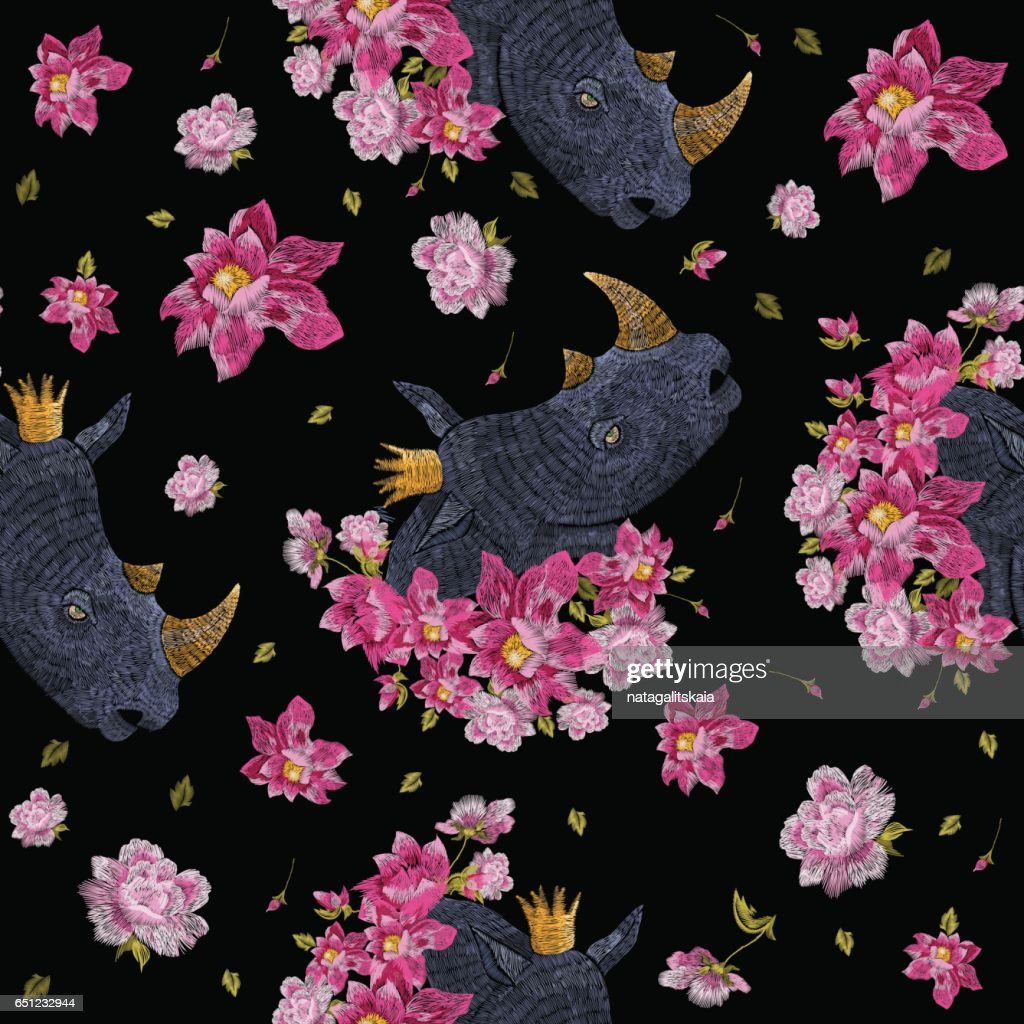 Embroidery colorful floral seamless pattern with rhinoceros.