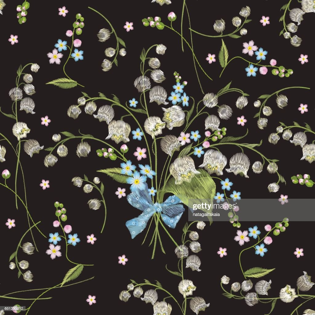 Embroidery colorful seamless pattern with lilies.