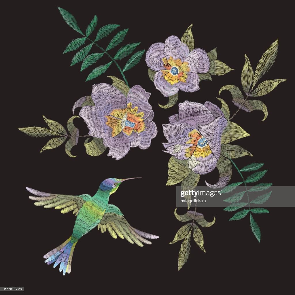Embroidery ethnic pattern with hummingbird and exotic flowers.