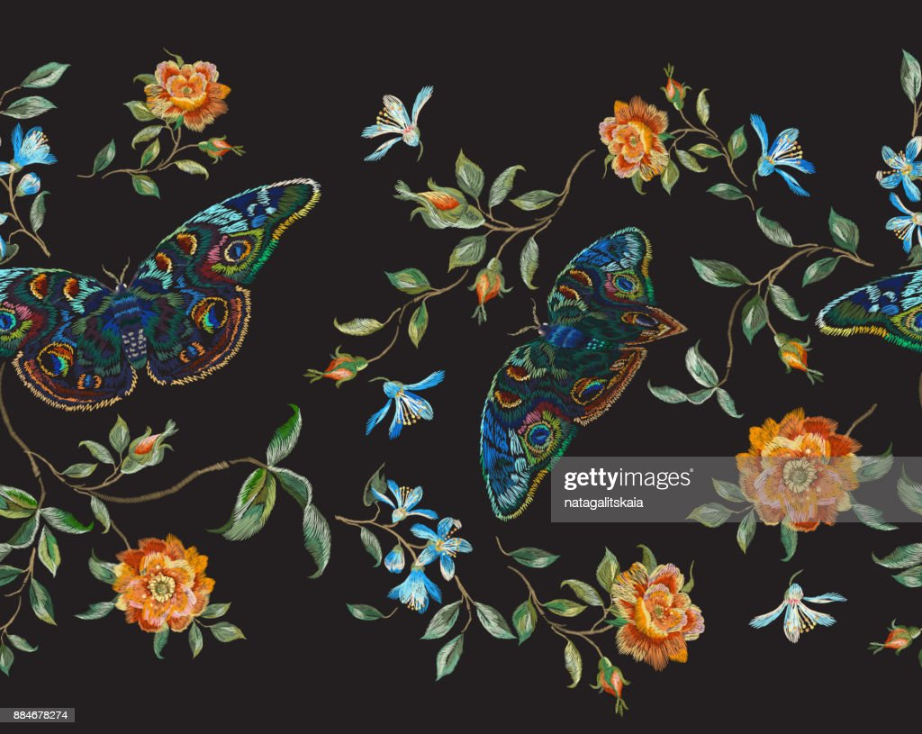 Embroidery floral seamless pattern with wild roses and butterflies.