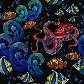 Embroidery octopus, sea wave and tropical fishes seamless pattern. Fashionable clothes, t-shirt design. Classical embroidery red octopus underwater, wave, fishes, seamless fashion pattern