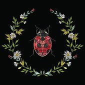 Embroidery round floral pattern with chamomiles and ladybug.