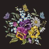Embroidery trend floral bouquet with pansies, chamomiles and forget me nots.