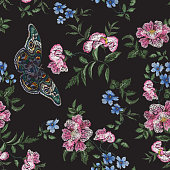 Embroidery trend floral pattern with wild roses and butterflies.