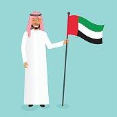 Emirati man holding UAE national flag.