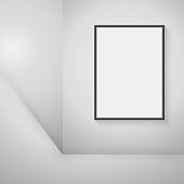 Empty black frame hanging on the wall in the room