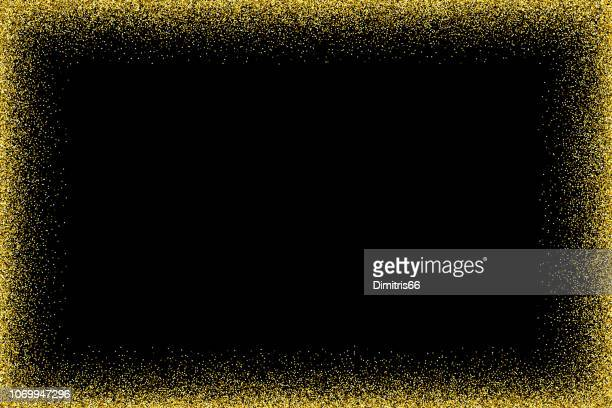 empty glitter gold frame on black background - at the edge of stock illustrations