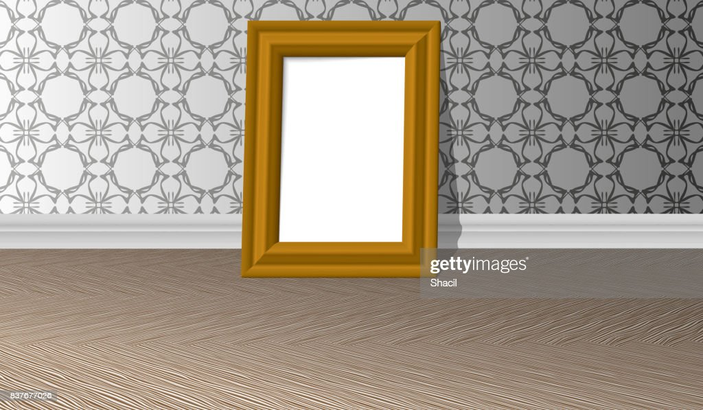 Empty golden horizontal picture frame on a white wall with patterns and parquet floor, design template