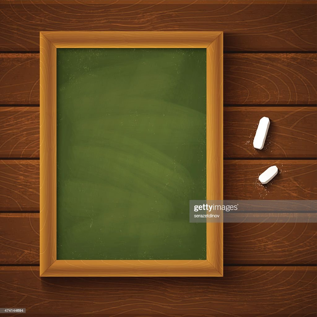 Empty green chalkboard and chalk