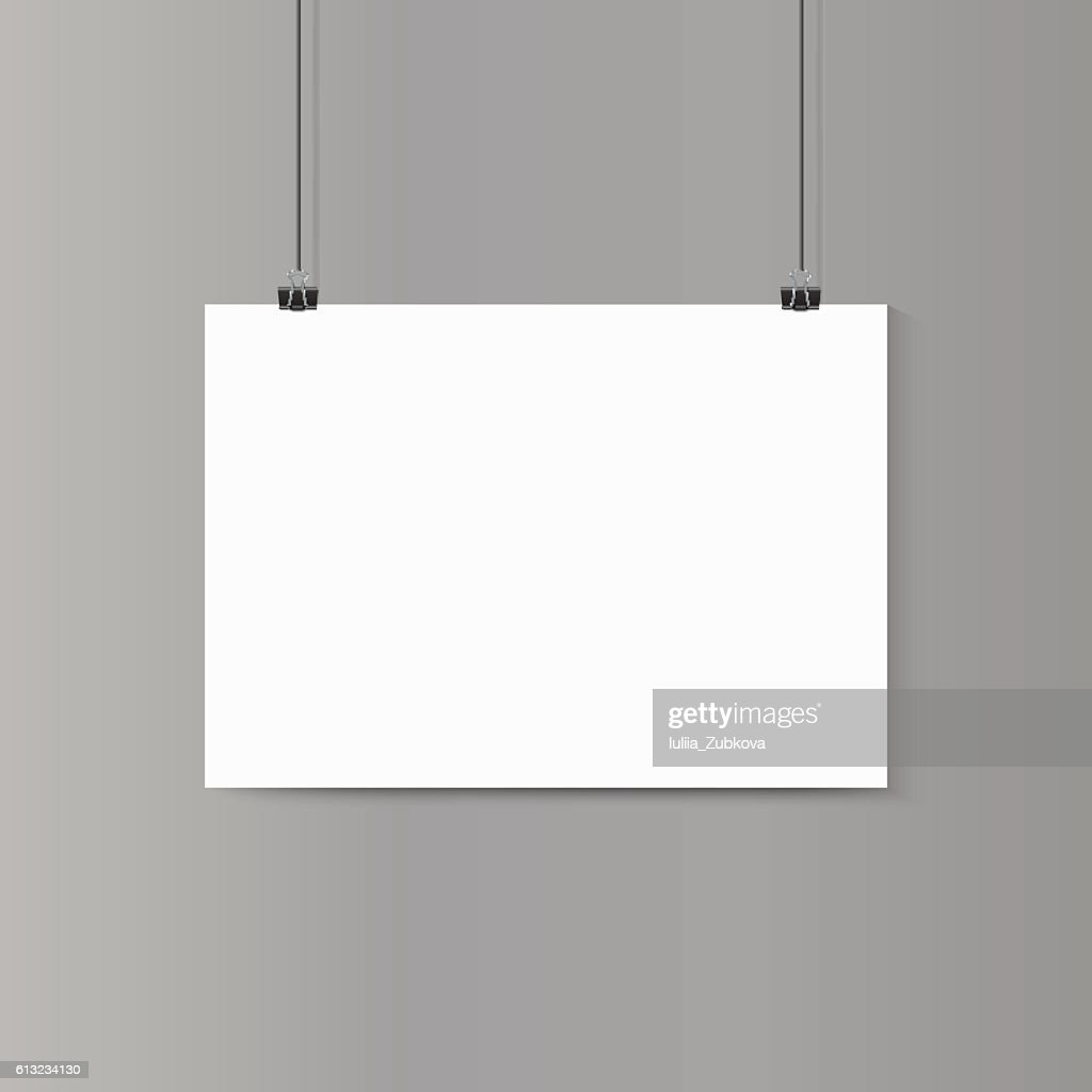 Empty horizontal white paper poster mockup on grey wall with