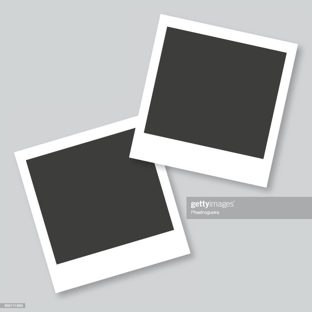 Empty photo frames in gray background