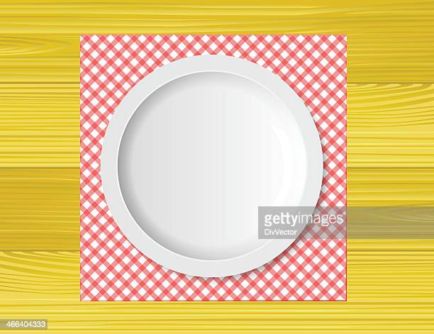 empty plate on wooden tabletop with tablecloth - kitchenware department stock illustrations, clip art, cartoons, & icons