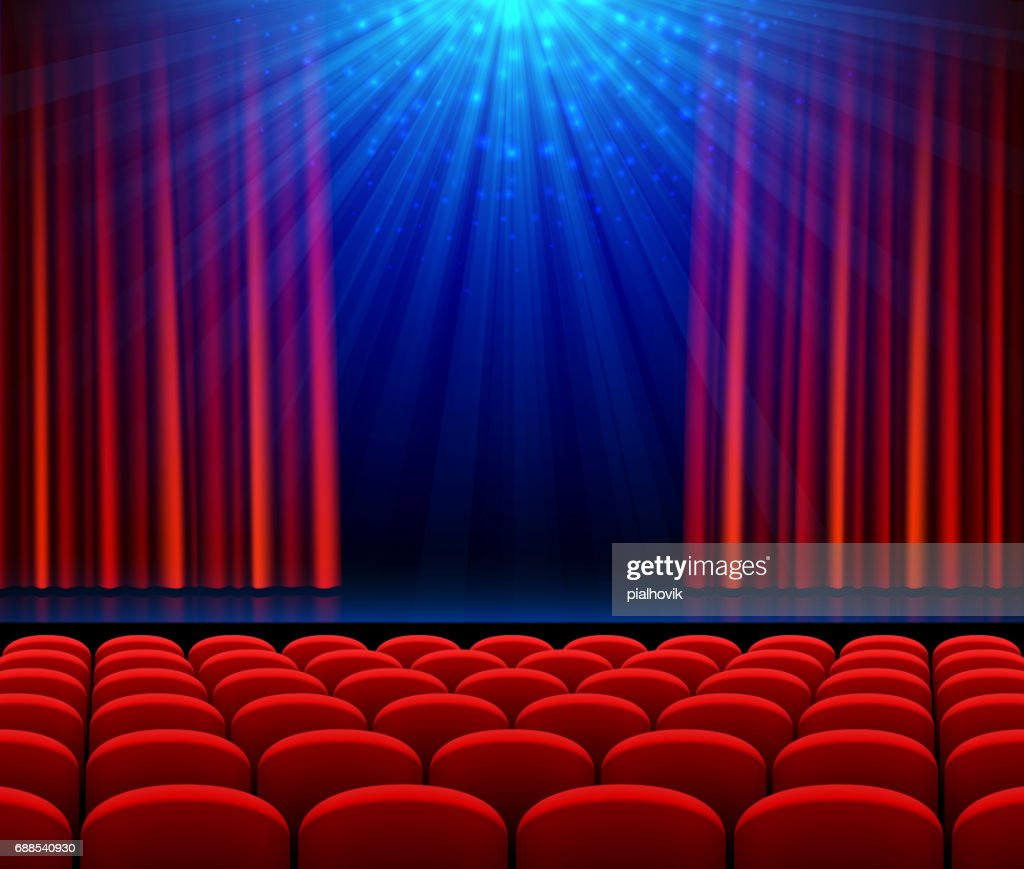 Empty theater stage with red opening curtain