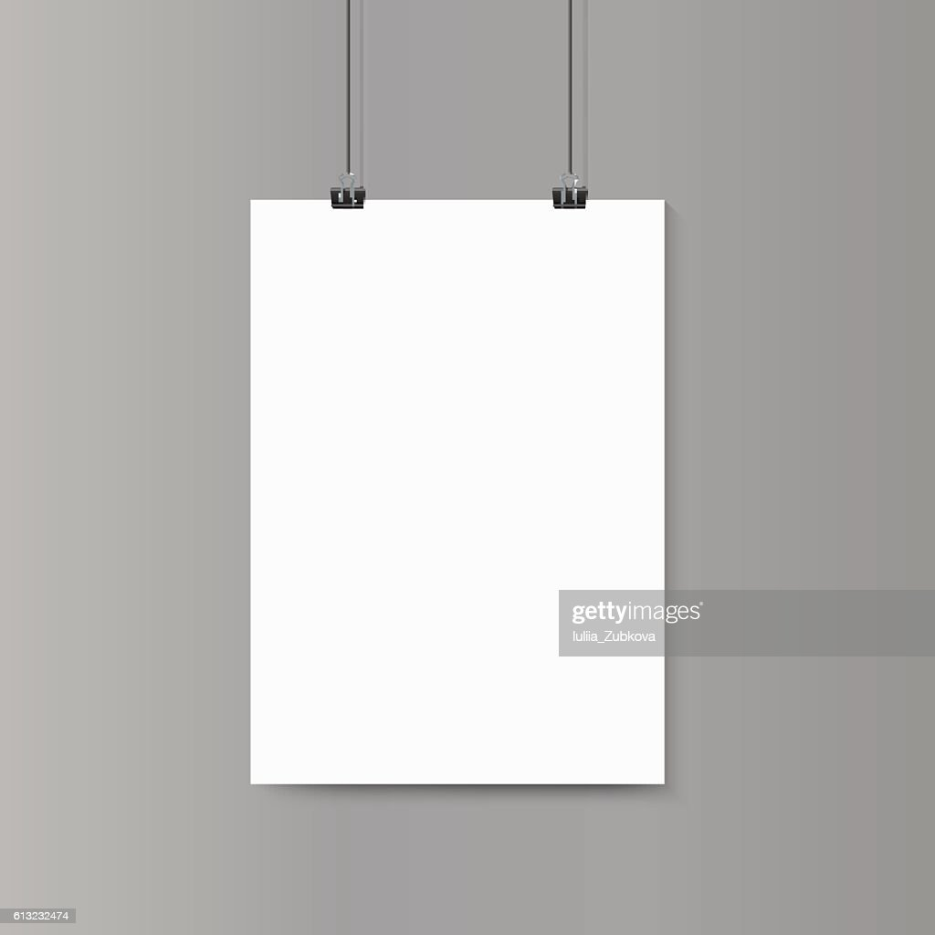 Empty vertical white paper poster mockup on grey wall with