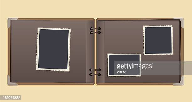 A empty vintage photo album on a beige background
