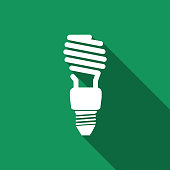Energy saving light bulb icon isolated with long shadow. Flat design. Vector Illustration